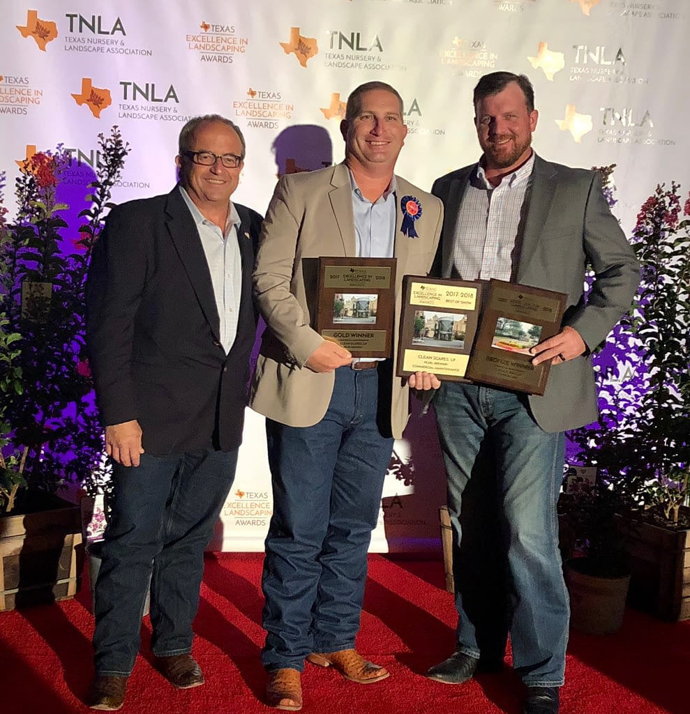 Pictured Left to Right: Ivan Giraldo, Richie Bartek, Matt Stults accepting an award for Texas Excellence in Landscaping