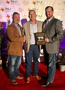 Pictured from Left to Right- Brett Nichols, Richie Bartek, Matt Stults accepting an award for Texas Excellence in Landscaping