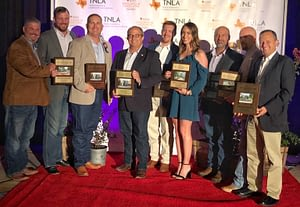 Pictured Left to Right- Brett Nichols, Matt Stults, Richie Bartek, Ivan Giraldo, Alex Lee, Kaleigh Meighen, Jorge Espinosa, Greg Fox & Gustavo Calero accepting an award for Texas Excellence in Landscaping
